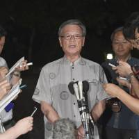 Okinawa Gov. Takeshi Onaga comments on the prefectural assembly election early Monday morning in Naha, Okinawa Prefecture. | KYODO