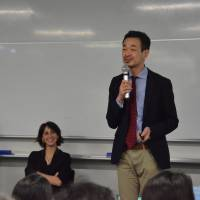 Panama Papers team member Yasuomi Sawa, of Kyodo News, addresses a symposium in Tokyo on June 2. | KYODO