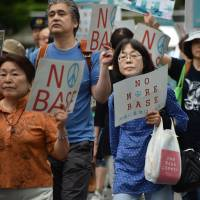 Anti-U.S. base protesters take part in demonstration in central Tokyo