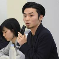Aki Okuda, head of the youth activist group SEALDs, speaks at a Tokyo news conference on March 28. | KYODO
