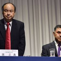 SoftBank founder Masayoshi Son (left) and the then president of the company, Nikesh Arora, attend a news briefing to announce its earnings results in Tokyo in November 2015. The company is under increased scrutiny over Son's long-term strategy after the surprise departure of his heir apparent, Arora, on Wednesday. | AFP-JIJI