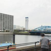 Woman's body found in suitcase floating in Tokyo canal