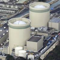 Reactor 1 (foreground) and reactor 2 are seen in January at Kansai Electric Power Co.'s Takahama nuclear plant in Fukui Prefecture. | KYODO