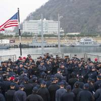 An all-hands call is held aboard the guided-missile destroyer USS Benfold in this file image from April. The ship operates out of Yokosuka Naval Base within the U.S. 7th Fleet. | NAVY MEDIA CONTENT SERVICES