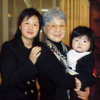 Sakie Yokota (center) is pictured with her 10-month-old great-granddaughter and granddaughter, Kim Eun Gyong, in this handout photo taken during a rare family reunion in Mongolia in March 2014. | KYODO