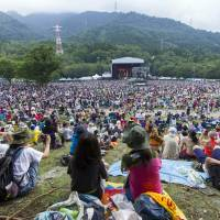 On the grass: Fuji Rock Festival is known for its family friendly environment.  | JAMES HADFIELD