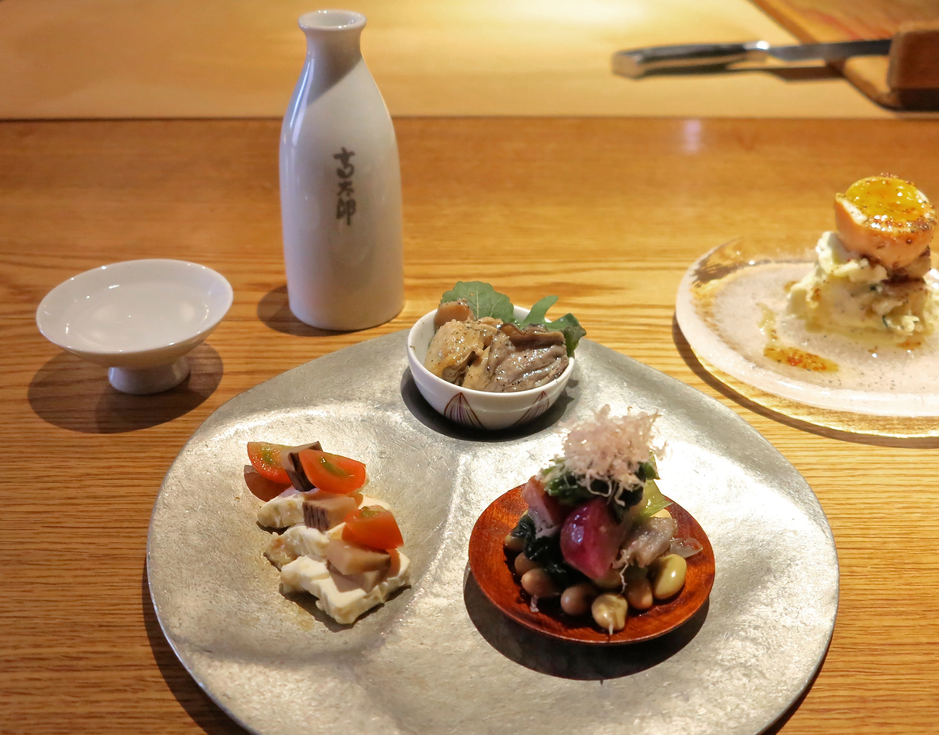 Sake and nibbles: Meals at Kotaro in Shibuya open with an assorted appetizer plate, with an emphasis on organic seasonal vegetables. | ROBBIE SWINNERTON