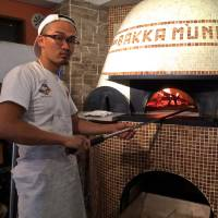 Yutaka Hazama, the owner of Bakka M'unica, has entered pizzaiolo competitions in Naples but prefers to follow his own unorthodox path. Before opening Bakka M'unica in the spring of 2016, he operated out of his pizza truck. | ROBBIE SWINNERTON