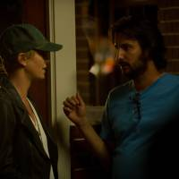 Tough calls: Director Gilles Pacquet-Brenner directs Charlize Theron as Libby Day on the set of 'Dark Places.' | © 2014 DAMSELFISH HOLDINGS, LLC, ALL RIGHTS RESERVED