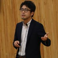 Watching the watchers: Lawyer Daisuke Igeta speaks at the Tokyo symposium on surveillance and civil rights.   IAN MUNROE