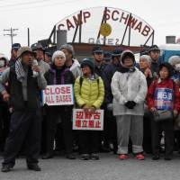 Leader of the pack: Hiroji Yamashiro addresses demonstrators after successfully blocking the gates of U.S. Marine Corps Camp Schwab, Nago. | JON MITCHELL