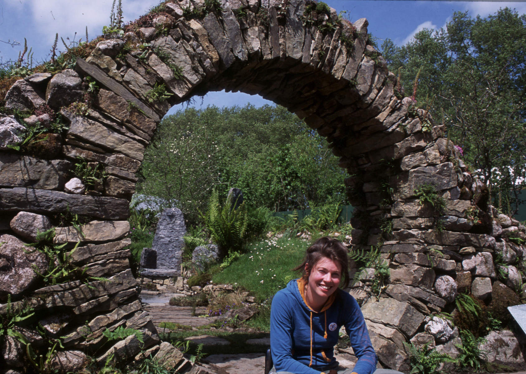 Mary Reynolds sits in front of the moon gate of her 'Celtic Sanctuary' garden, which won gold at the Chelsea Flower Show in 2002. | © 2014 CROW'S NEST PRODUCTIONS