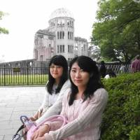 Chikako Hama (left), Student, 21 (Japanese): It surprised me that the sitting president of the United States actually came here. I was astonished too that he talked face to face with hibakusha. I hope this will lead to the end of nuclear weapons. / Yui Nakajima, Student, 22 (Japanese): President Obama represents the U.S. He came here and saw in person what has happened. It's a historic moment and a chance to make sure that the same thing will never happen again.