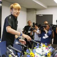 Takashi Usami participates in a news conference on Tuesday in Osaka. | KYODO