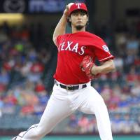 Darvish leaves start after five innings with sore shoulder