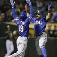 Rangers use homers to rally past A's