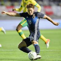 Takuma Asano takes a shot during the first half of Japan's friendly against South Africa on Wednesday in Nagano. | KYODO