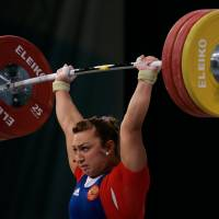 Russian weightlifting medalists fail doping tests from Beijing Olympics