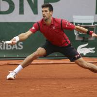 Djokovic beats Berdych, punches ticket to French Open semifinals