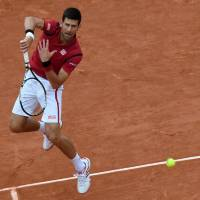 Djokovic passes $100 million mark at French Open