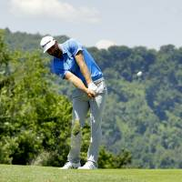 Johnson tied for lead at U.S. Open