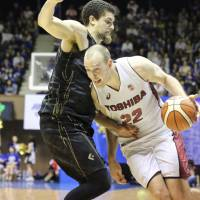 Toshiba big man Nick Fazekas dribbles during Toshiba's 76-70 win over the SeaHorses in Game 5 of the NBL Finals in Tokyo on Sunday. With the victory, the Brave Thunders captured the league title. | KAZ NAGATSUKA