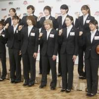 The Japan women's basketball team for the Rio de Janeiro Olympics poses for a photo at a Tokyo news conference on Monday. | KAZ NAGATSUKA