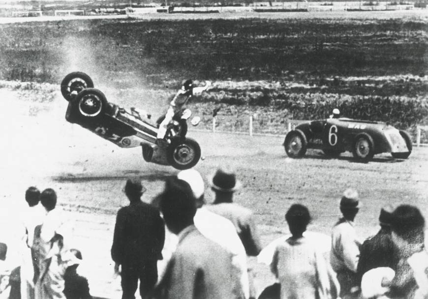 A young Soichiro Honda, the founder of Honda Motor Co. Ltd., crashes during the first four-wheel competition held at Tamagawa Speedway in 1936.