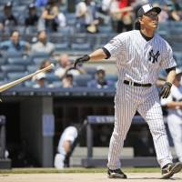 Back in pinstripes for Old-Timers' Day, 'Godzilla' crushes one more into second deck