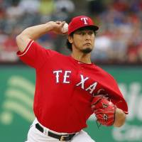 Texas' Darvish improves to 2-0
