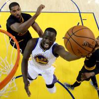 The Warriors' Draymond Green goes up for a shot during Game 7 of the NBA Finals on Sunday in Oakland, California. | REUTERS