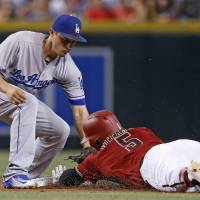Kershaw dominates as Dodgers beat Diamondbacks