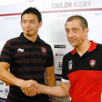 Ayumu Goromaru (left) poses during a news conference on Tuesday in Toulon, France. | KYODO