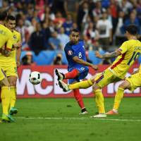 France's Dimitri Payet (center) scores against Romania in the opening game of Euro 2016 on Friday night at Stade de France. | AFP-JIJI