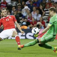 Wales blasts Russia to win group as Bale scores again