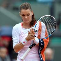 Radwanska loses as rain continues to wreak havoc