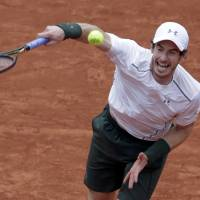 Murray sets up semi clash with Wawrinka