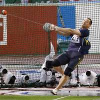 Koji Murofushi competes in the men's hammer throw at the National Athletics Championships at Paloma Mizuho Stadium in Nagoya on Friday. Murofushi placed 12th in the final, ending his quest to compete at the Rio Olympics. | KYODO
