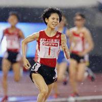 Ayuko Suzuki runs en route to victory in the women's 10,000-meter race at nationals on Friday in Nagoya. Suzuki completed the race in 31 minutes, 18.73 seconds. | KYODO