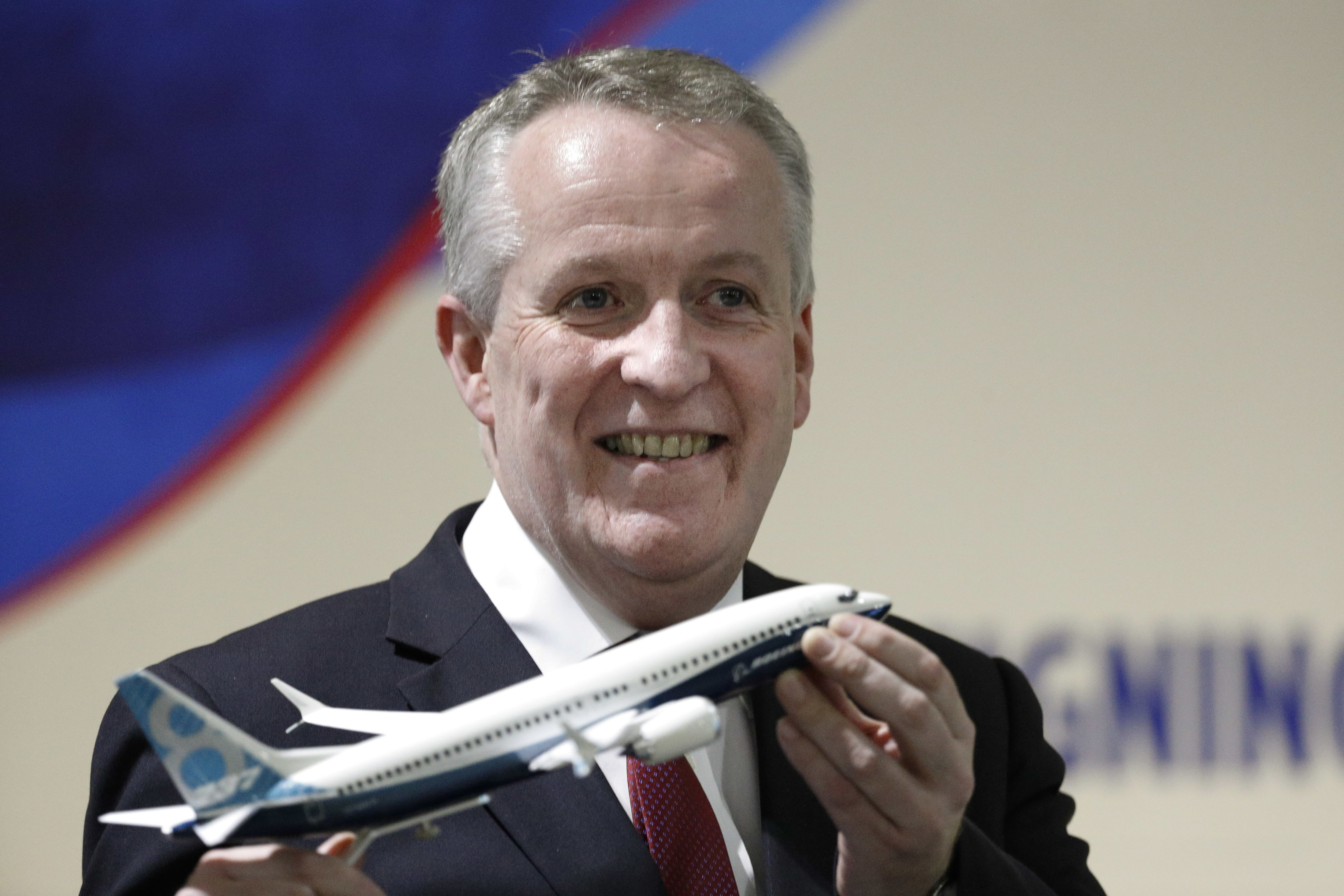 Malaysia Airlines Berhad (MAS) new Chief Executive Officer Peter Bellew holds a Boeing 737 MAX airplane model after a signing ceremony with Boeing in Putrajaya, Malaysia, Wednesday. Malaysia Airlines Berhad and Boeing announced a deal of 50 new 737 Max aircraft. | AP