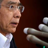 Bank of Japan Gov. Haruhiko Kuroda attends a news conference at the BOJ headquarters in Tokyo on Friday. | REUTERS