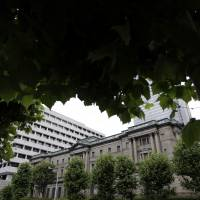 The Bank of Japan headquarters is seen in Tokyo in June. Japan is at the forefront of the helicopter money debate. | BLOOMBERG