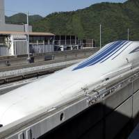 An L0 series maglev train, developed by Central Japan Railway Co., sits on a track ahead of a trial run at the Yamanashi Maglev Test Track site in Tsuru, Yamanashi Prefecture, in June 2015. | BLOOMBERG