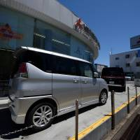 Mitsubishi Motors logs ¥130 billion net loss on fuel data scandal