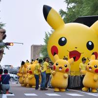 Pikachu characters parade at a festival in Yokohama in August 2015. | AFP-JIJI