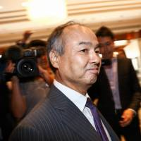 Masayoshi Son, chairman and chief executive officer of SoftBank Group Corp., leaves a news conference in London on Monday. | BLOOMBERG