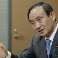 Government has no plans to issue deficit bonds to fund planned stimulus package: Suga