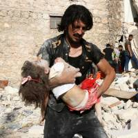 U.S.-led airstrikes on Islamic State-held villages in Syria kill 56 civilians, activists claim