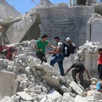 Rebels hit Syria regime targets after key Aleppo corridors are cut