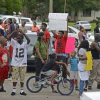 Protests after police fatally shoot black man in Louisiana